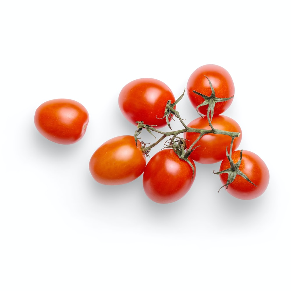 red tomatoes on white surface