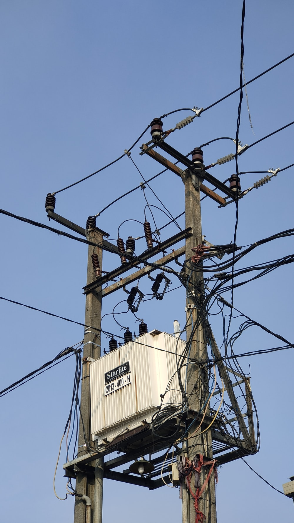 brown electric post with wires