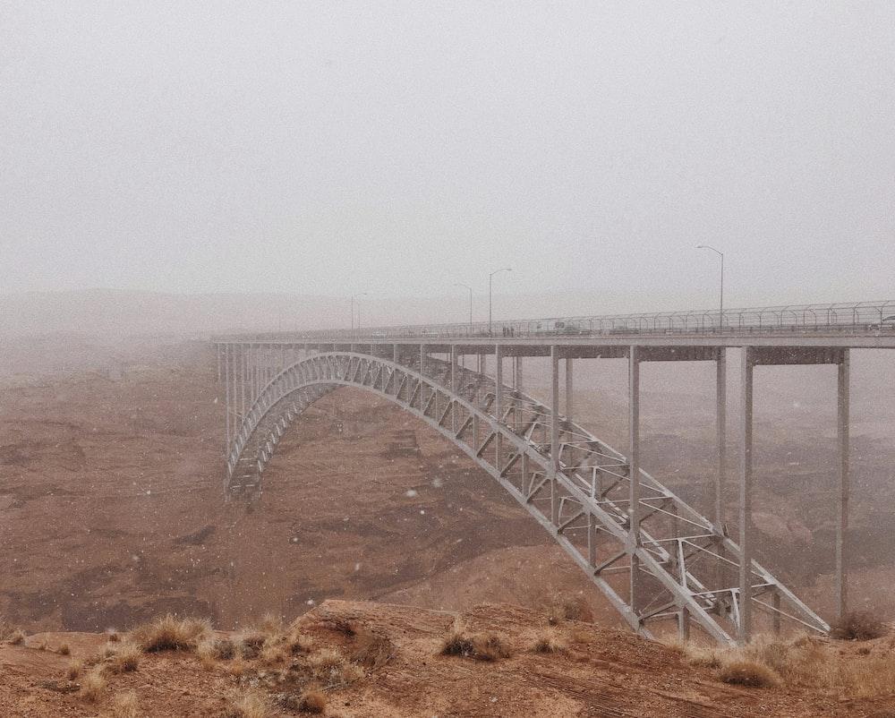 white metal bridge over the sea