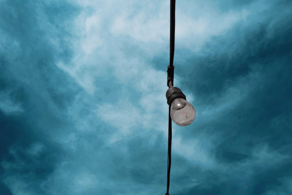 white light bulb under blue sky