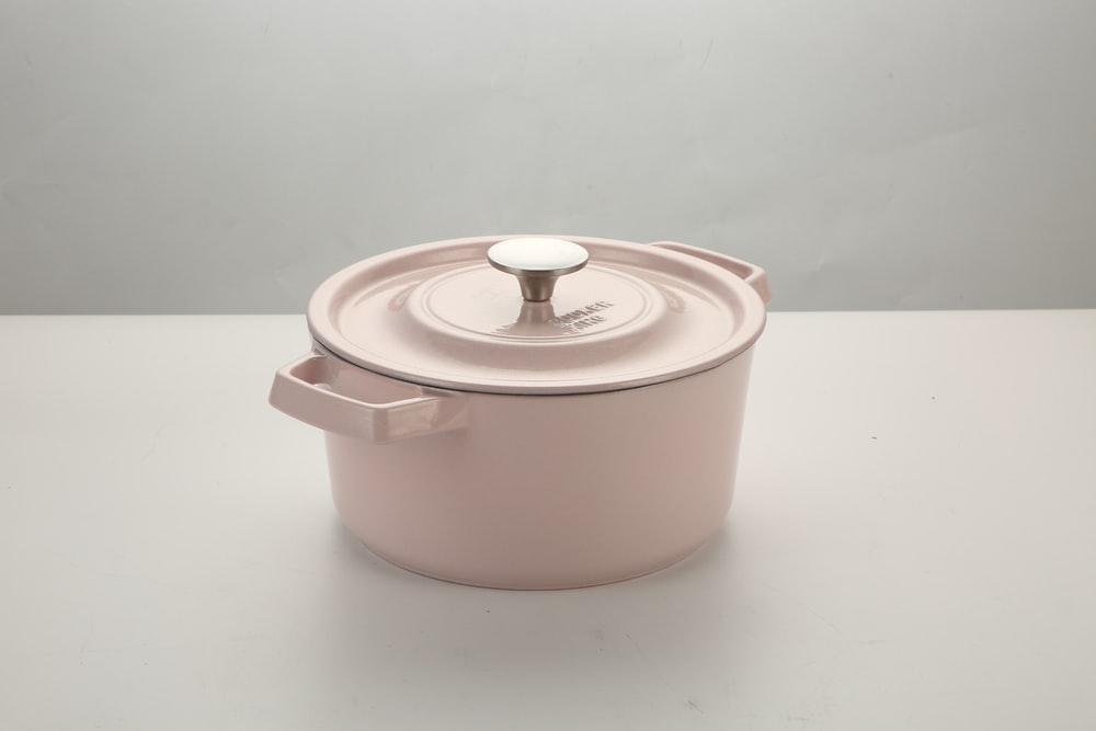 white and pink plastic container