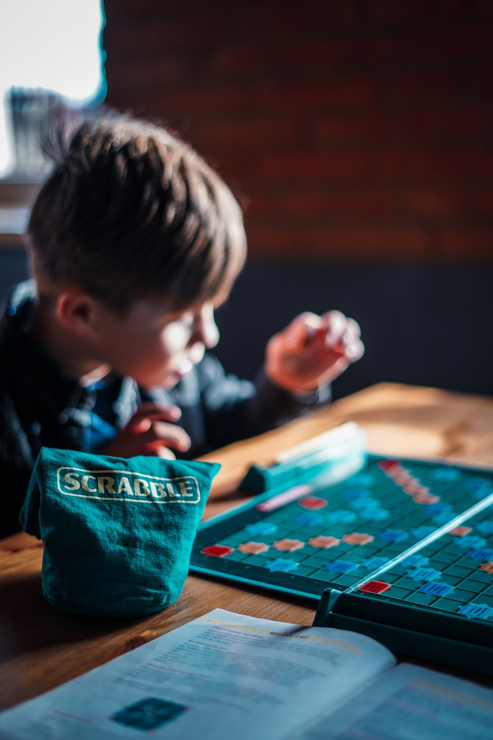 boy playing game on table