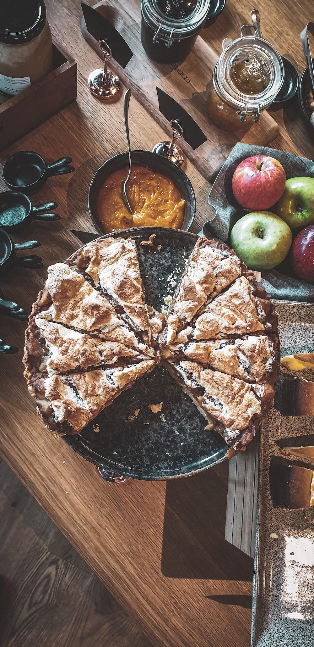 sliced pie on black round plate