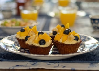 yellow and brown cupcakes on white ceramic plate