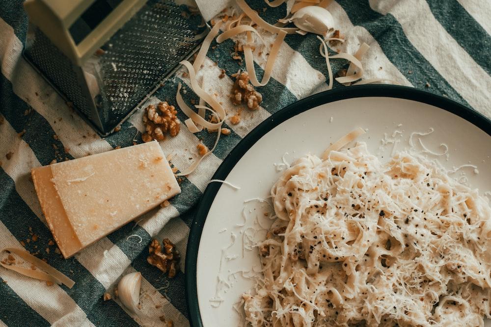 pasta dish on white and black ceramic plate