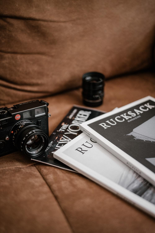 black and white camera lens on white book