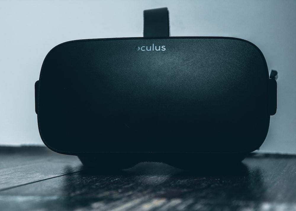 black jbl portable speaker on black table