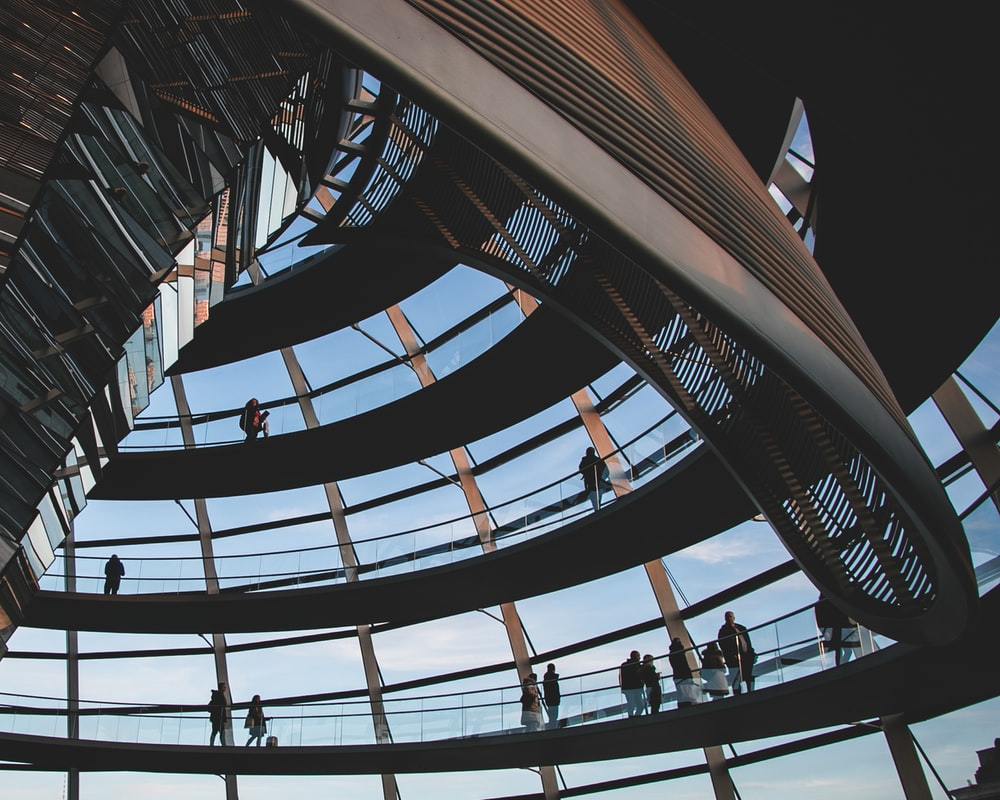 people walking on spiral staircase