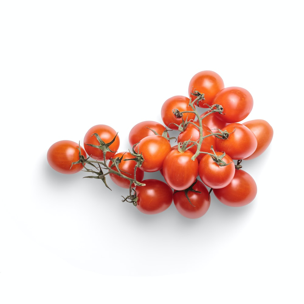 red tomatoes on white background