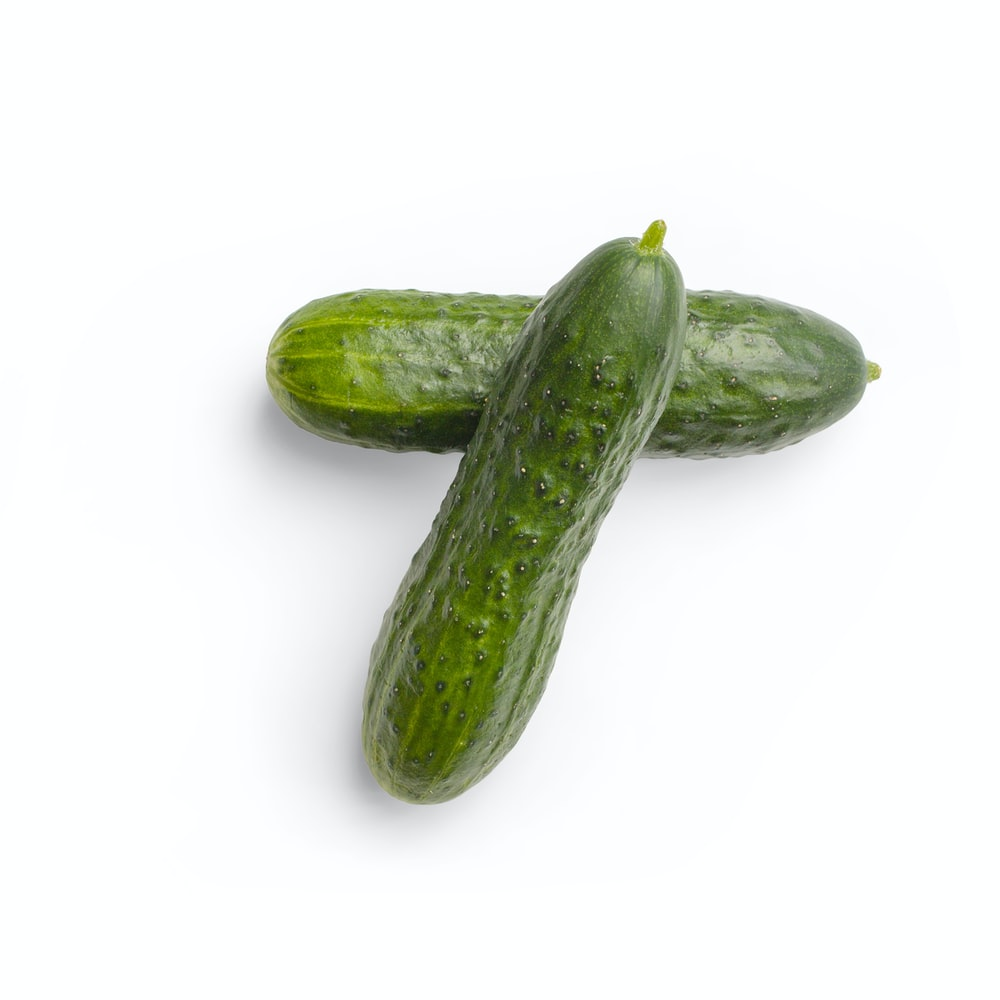 green cucumber on white surface