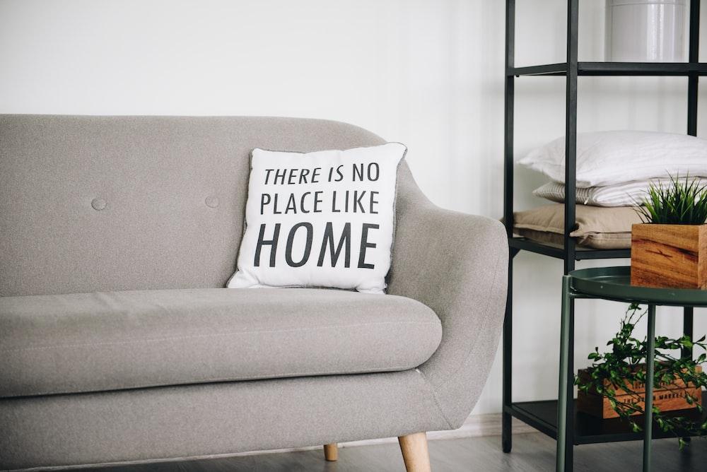 white throw pillow on gray sofa