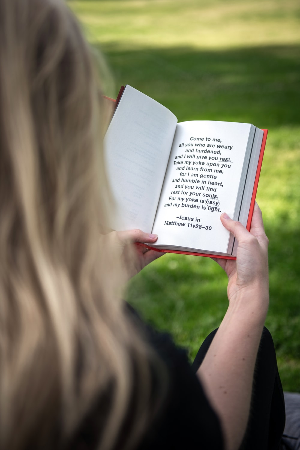 person holding white book page during daytime