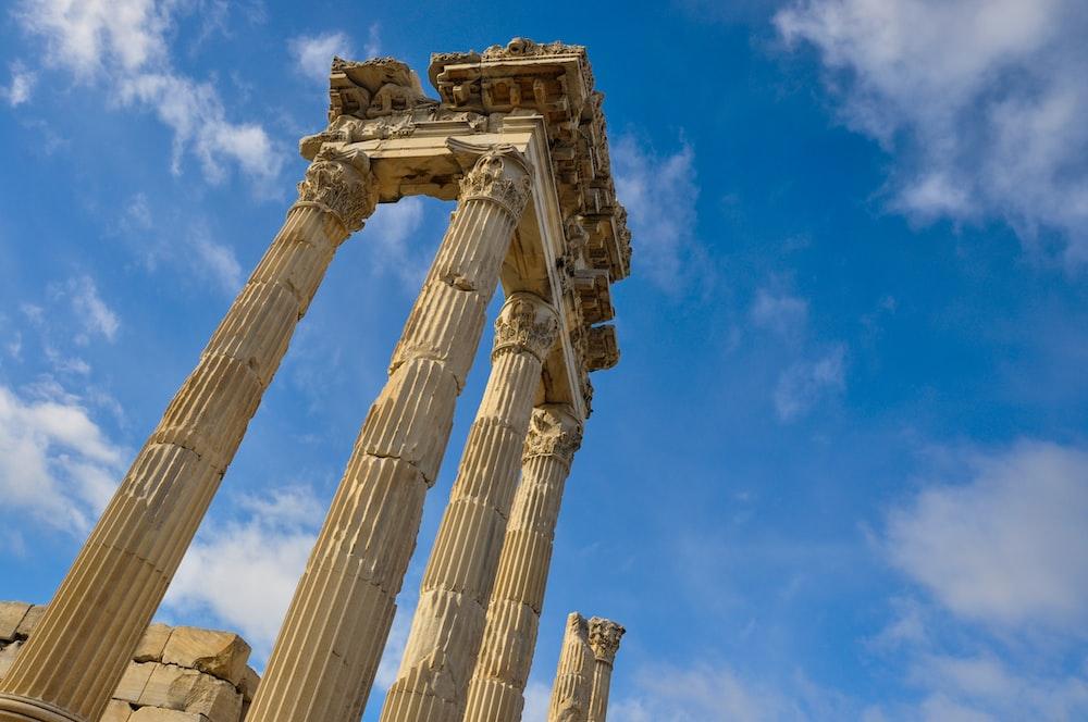 brown concrete pillar under blue sky during daytime