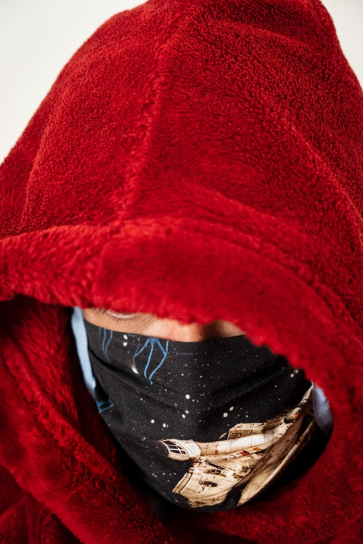 red textile on black textile