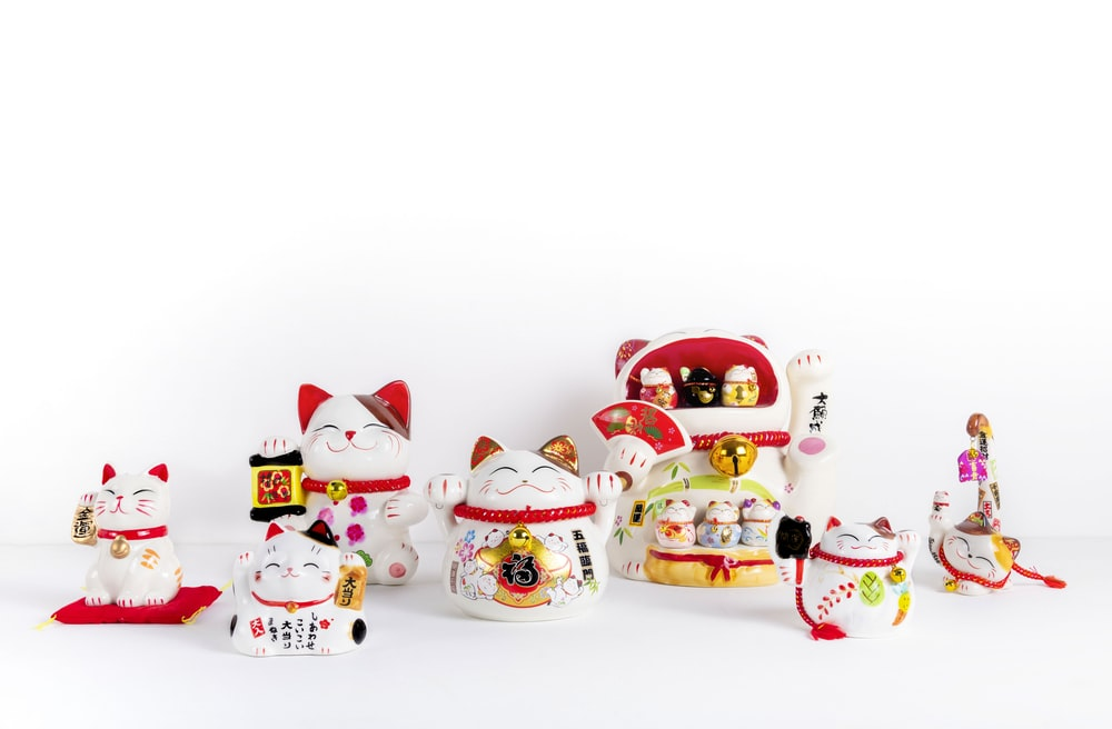white red and yellow ceramic snowman figurines