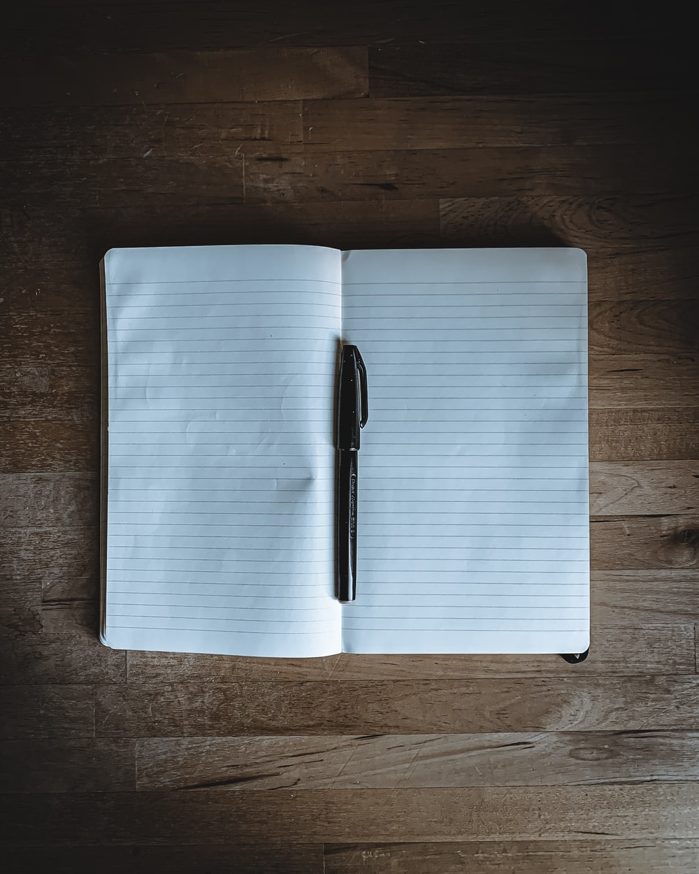 black click pen on white notebook