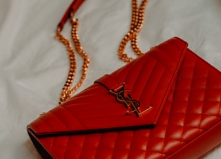 red leather flip case on white textile