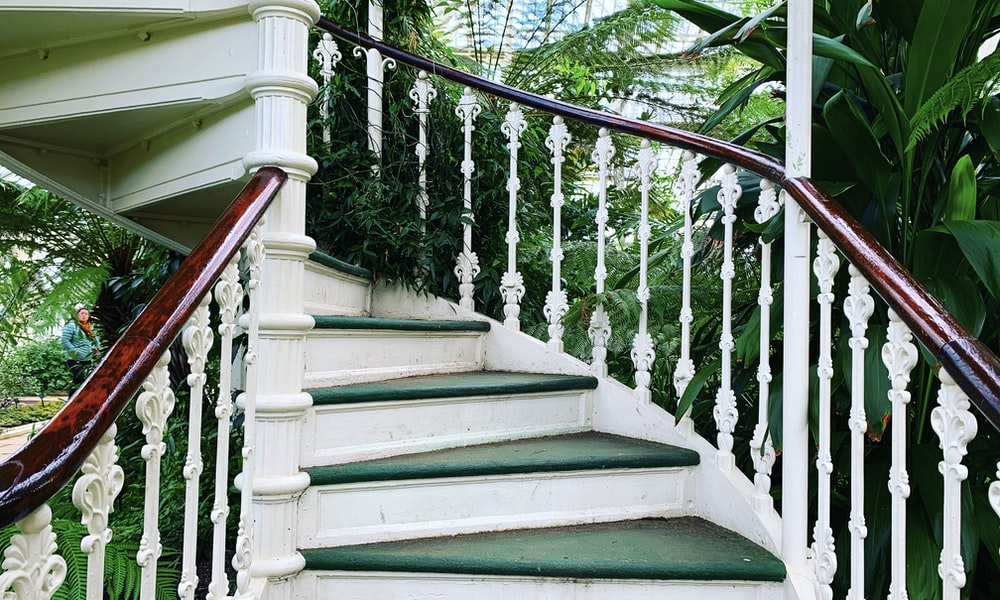 green and white wooden staircase