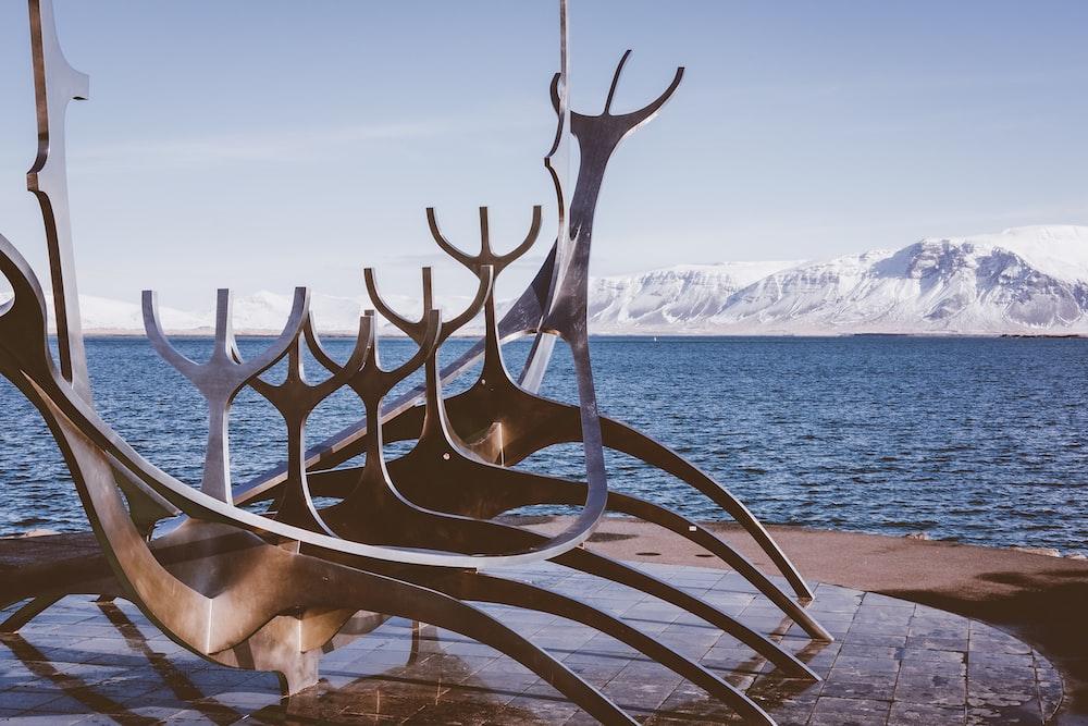 brown wooden animal sculpture on beach during daytime