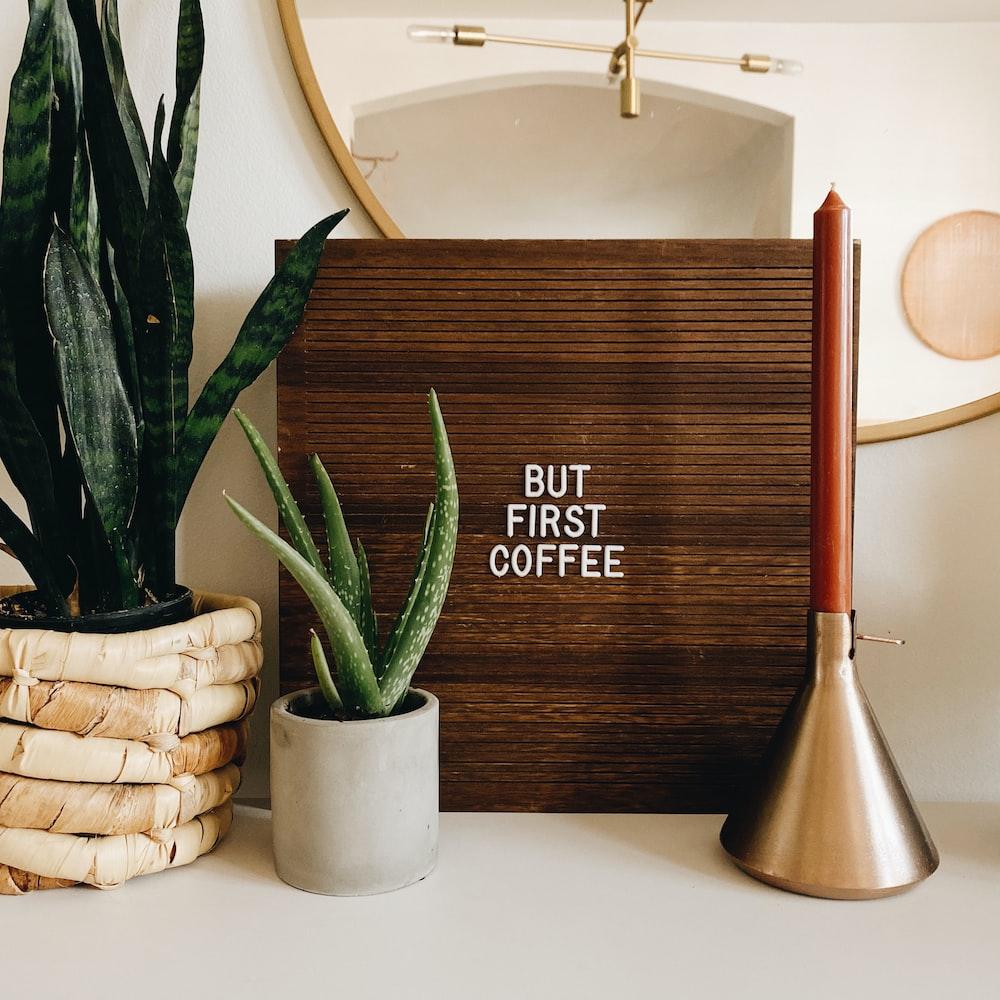 brown wooden vase beside white ceramic sink