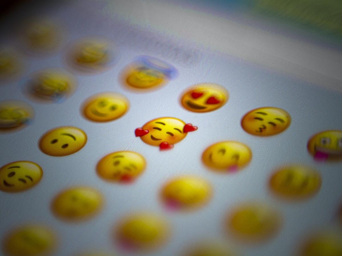 white yellow and green round plastic toy emoji