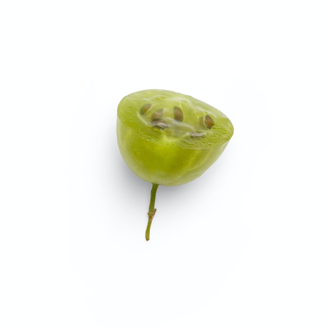 Quality photo of gooseberry half on a white background
