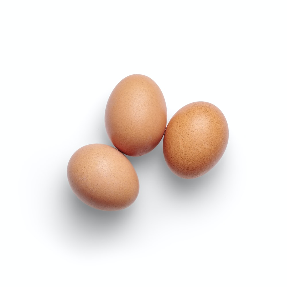 2 brown egg on white surface