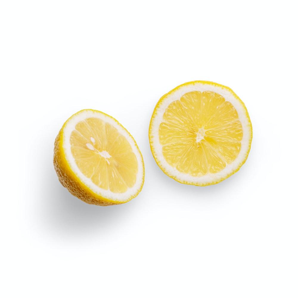 sliced orange fruit on white background