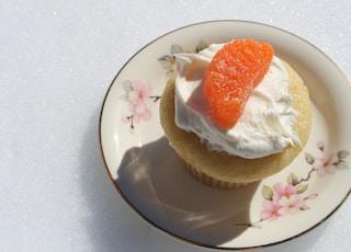 strawberry ice cream on white ceramic plate