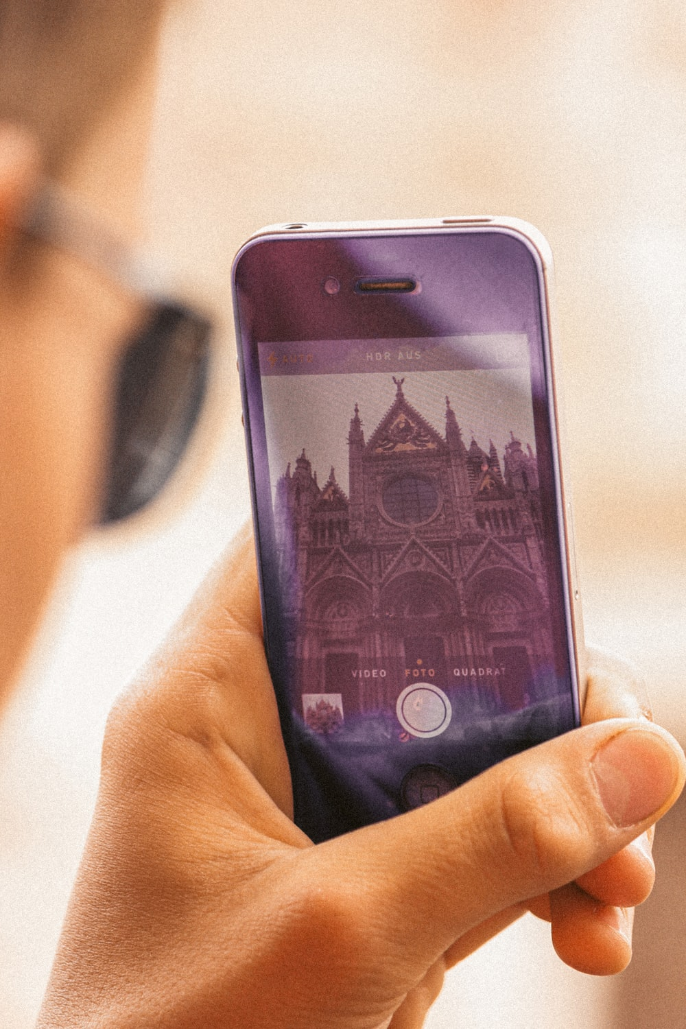person holding iphone 6 with purple case