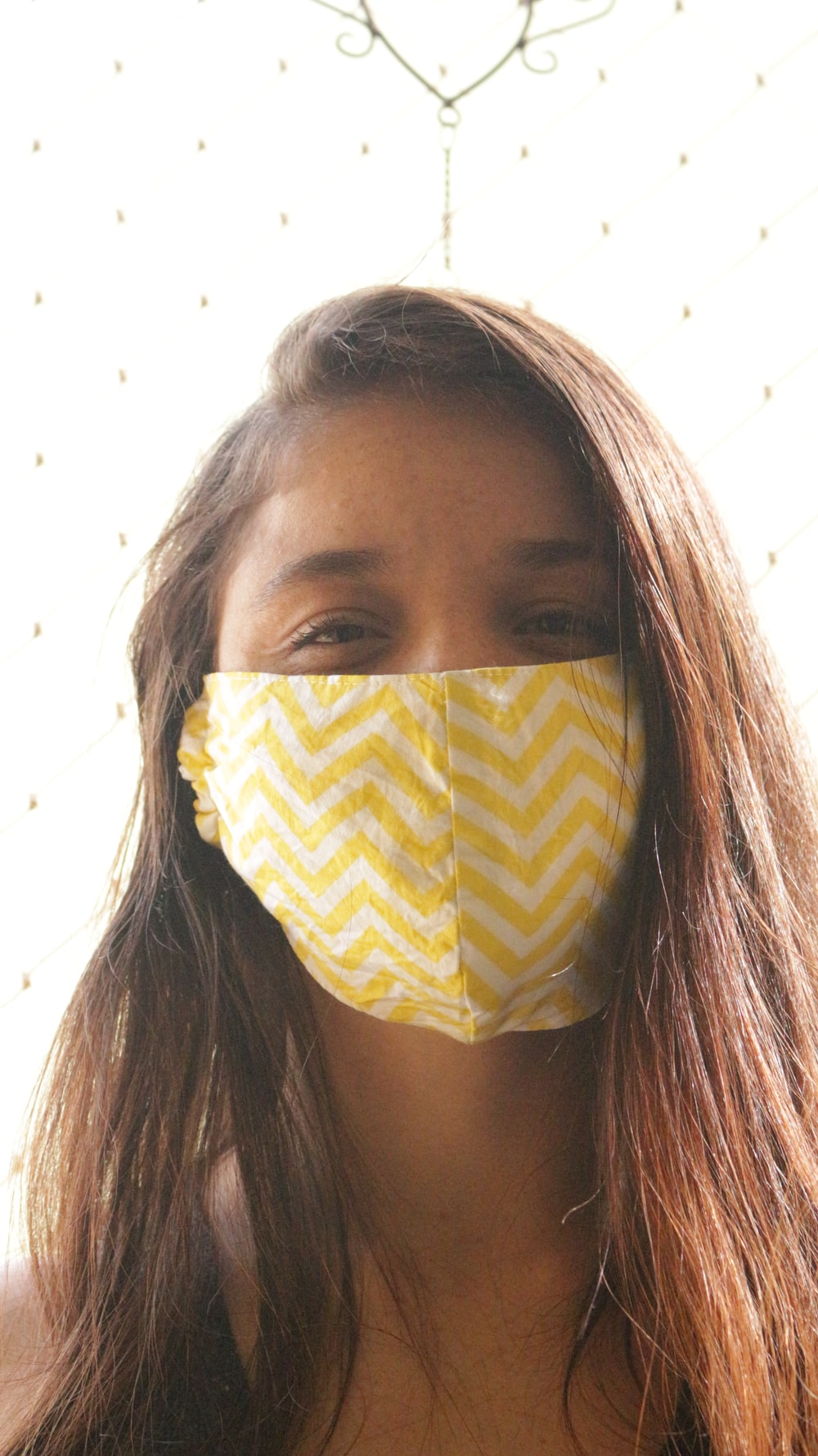 woman with yellow and white face mask