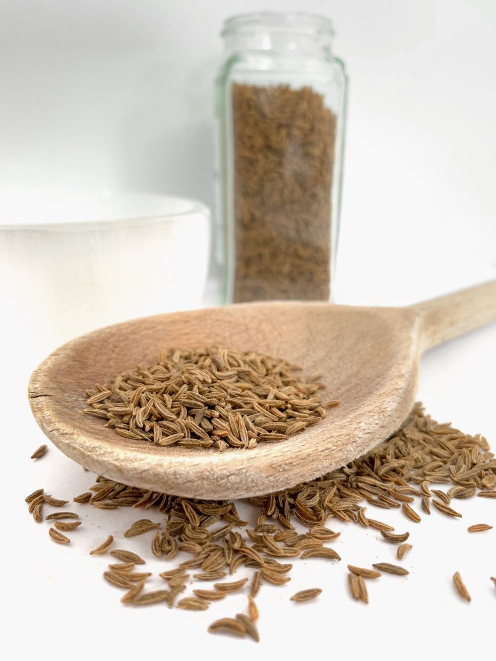 brown wooden spoon on white ceramic bowl