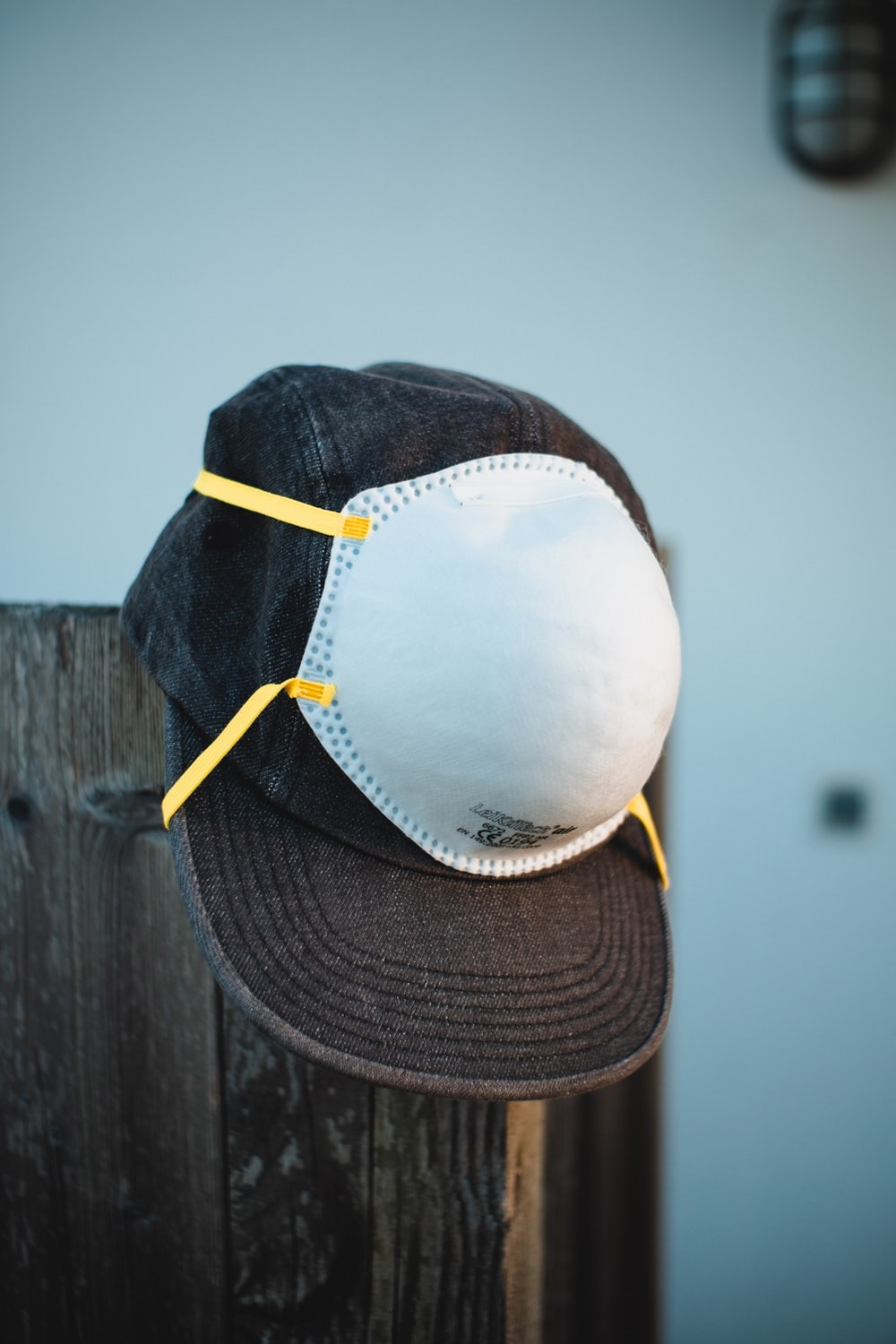 person wearing white and black baseball cap