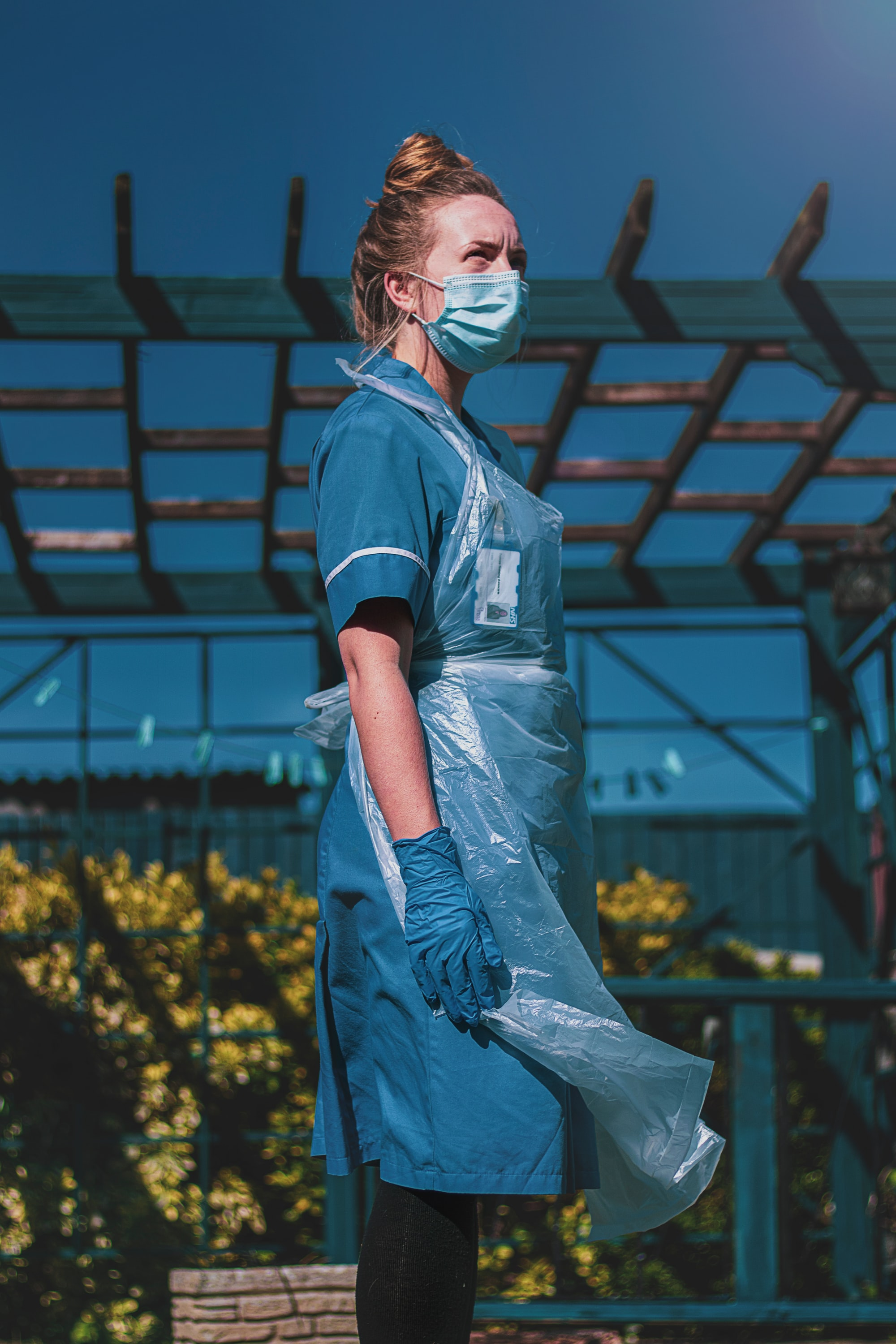 English NHS nurse staff in personal protection equipment (PPE) Key worker