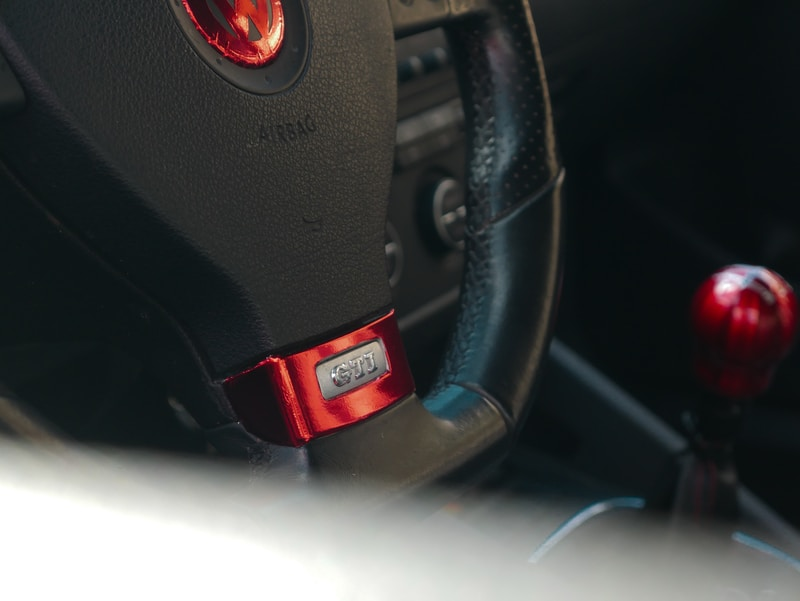 black and red honda steering wheel