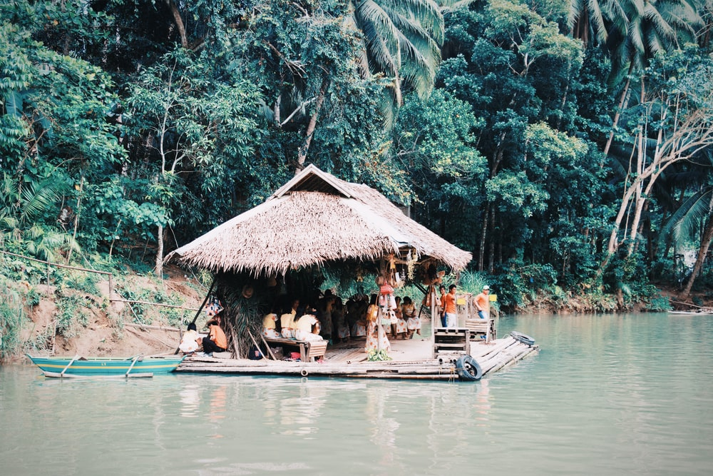 people riding boat on river during daytime