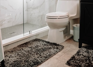 white ceramic toilet bowl beside white ceramic toilet bowl