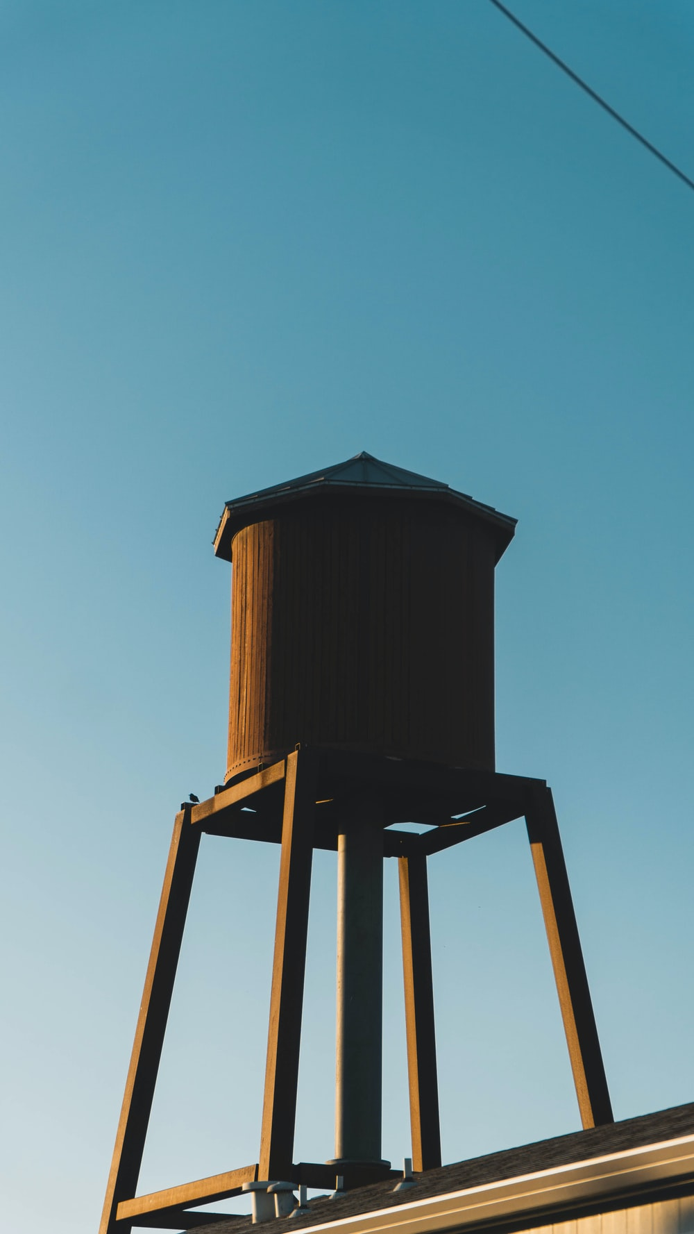 brown wooden tower under blue sky during daytime