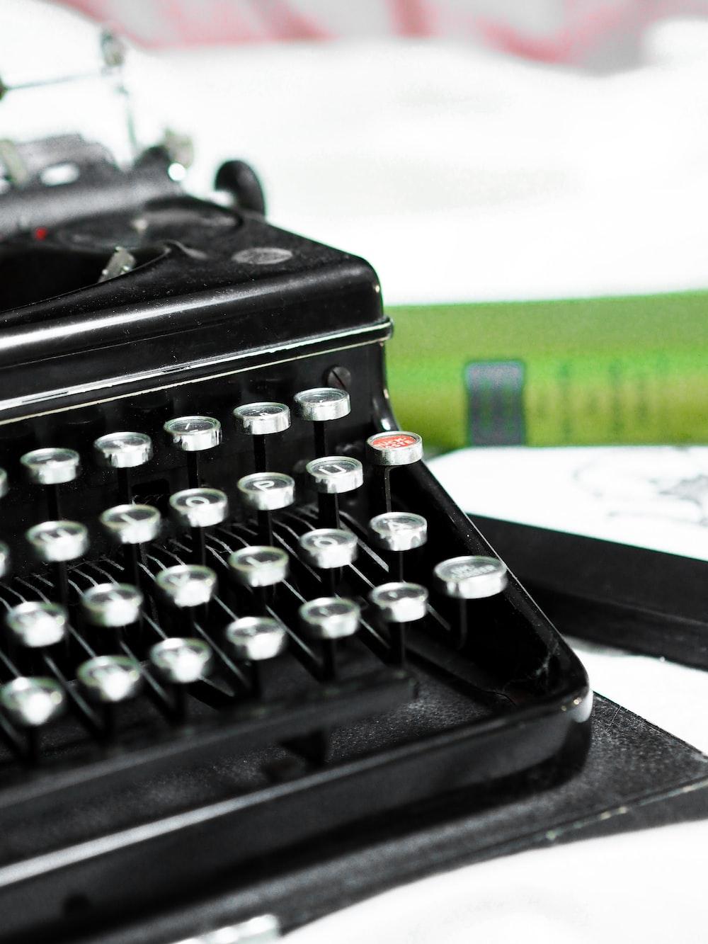 black typewriter on white table