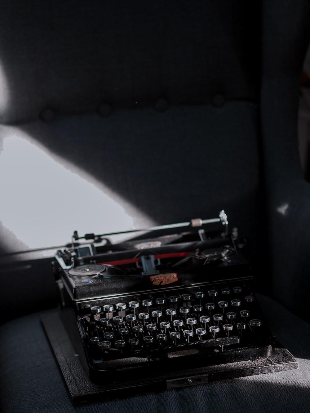 black typewriter on black car seat