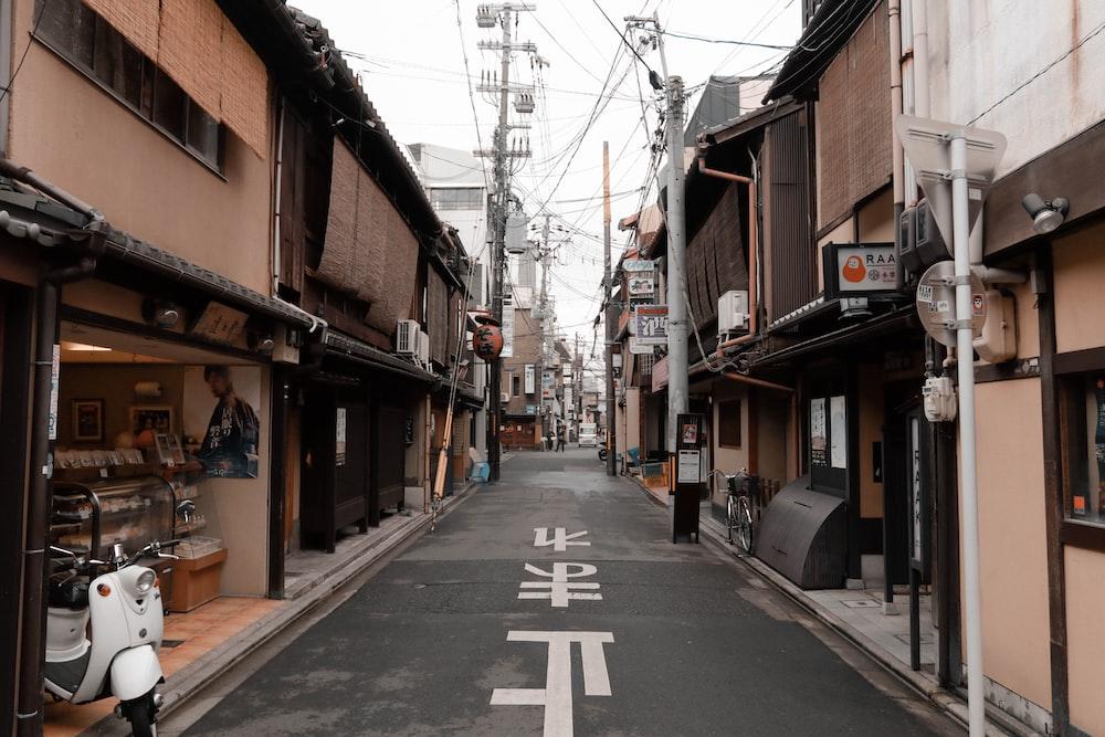 gray asphalt road between houses during daytime