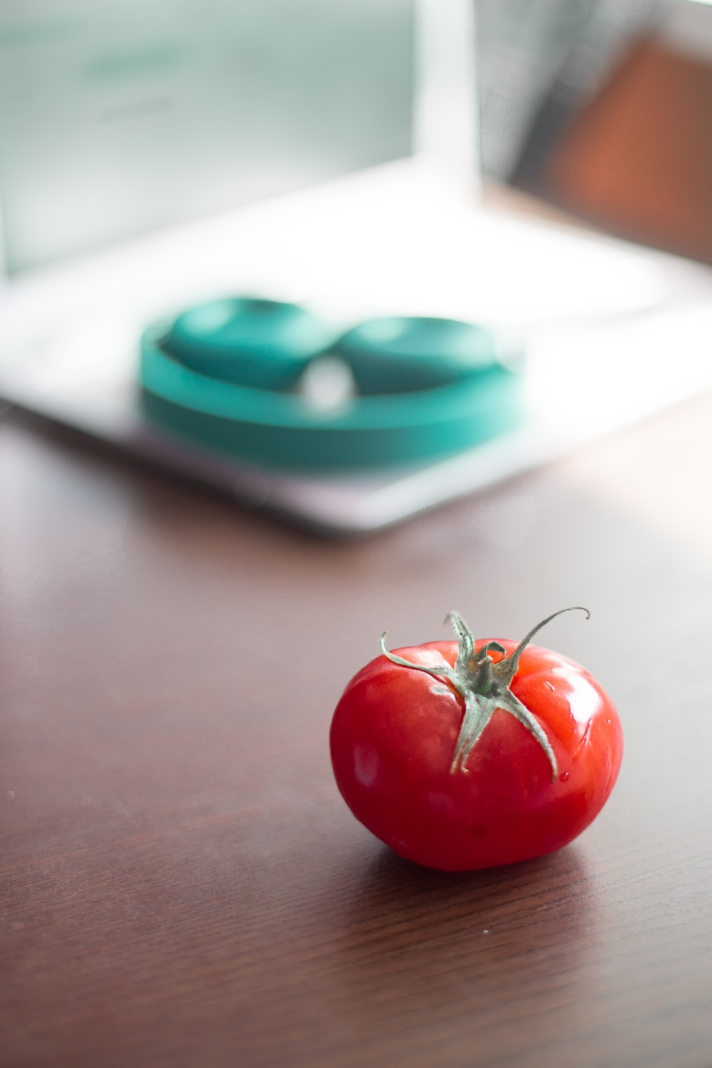 red tomato on brown table