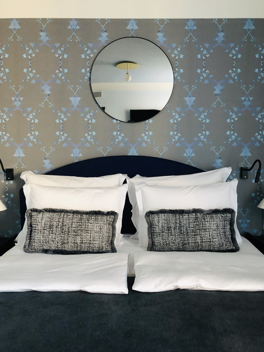 2 white wicker armchairs on white bed