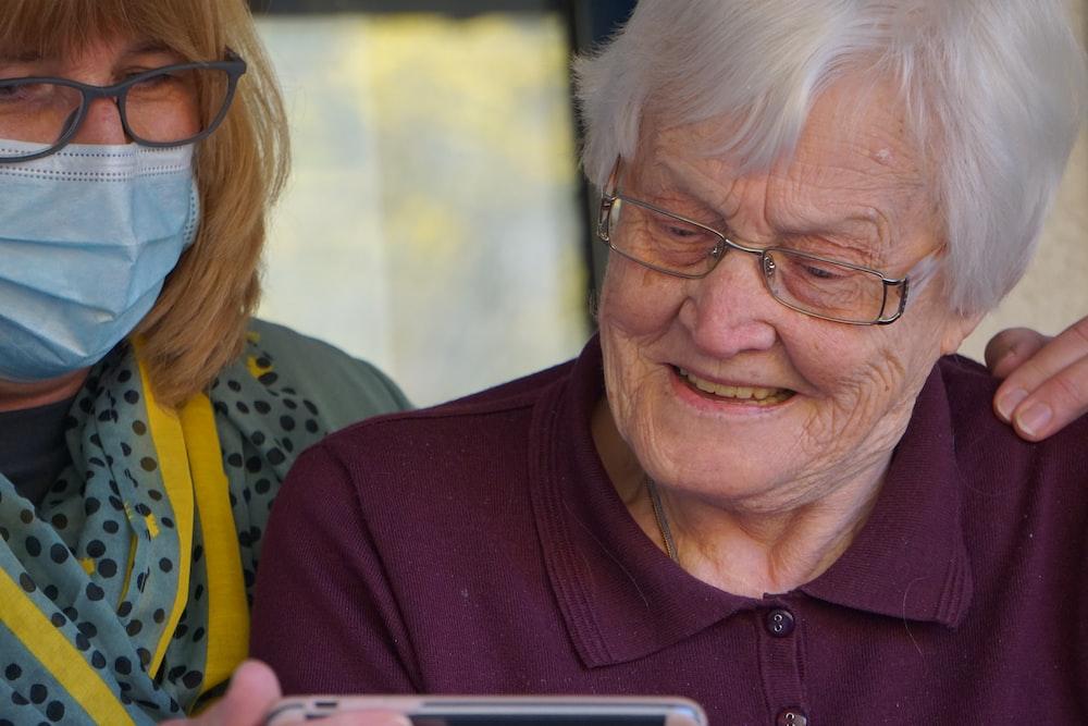 woman in purple polo shirt wearing eyeglasses