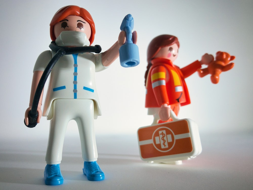 boy in blue and white suit plastic toy
