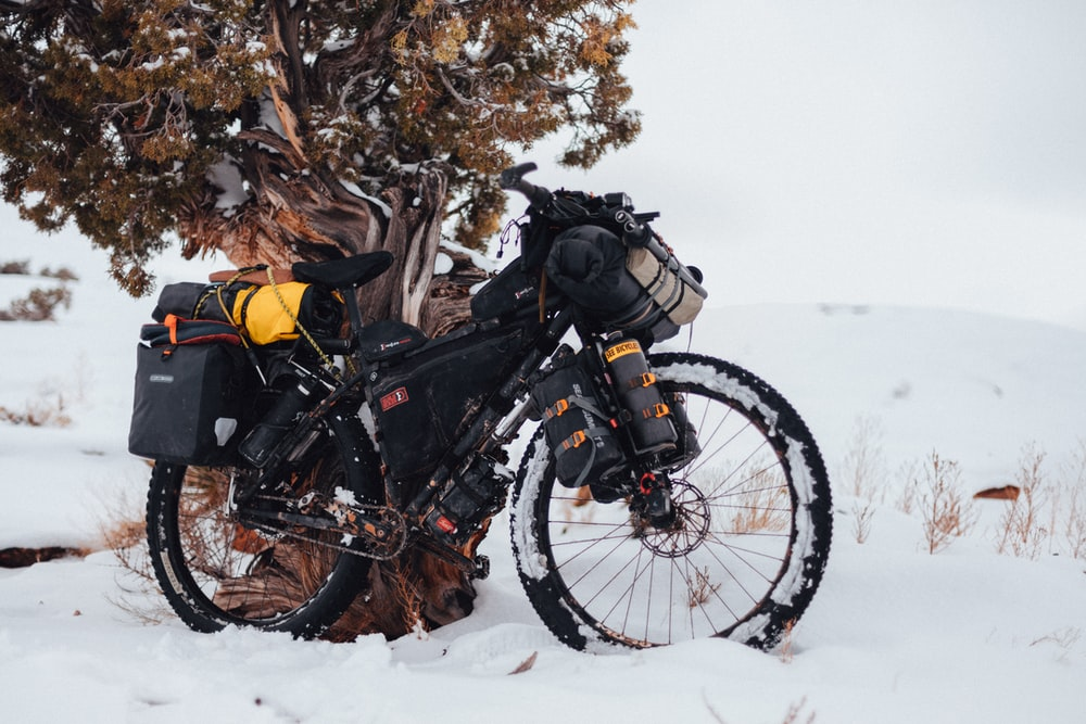 black and yellow motorcycle on snow covered ground