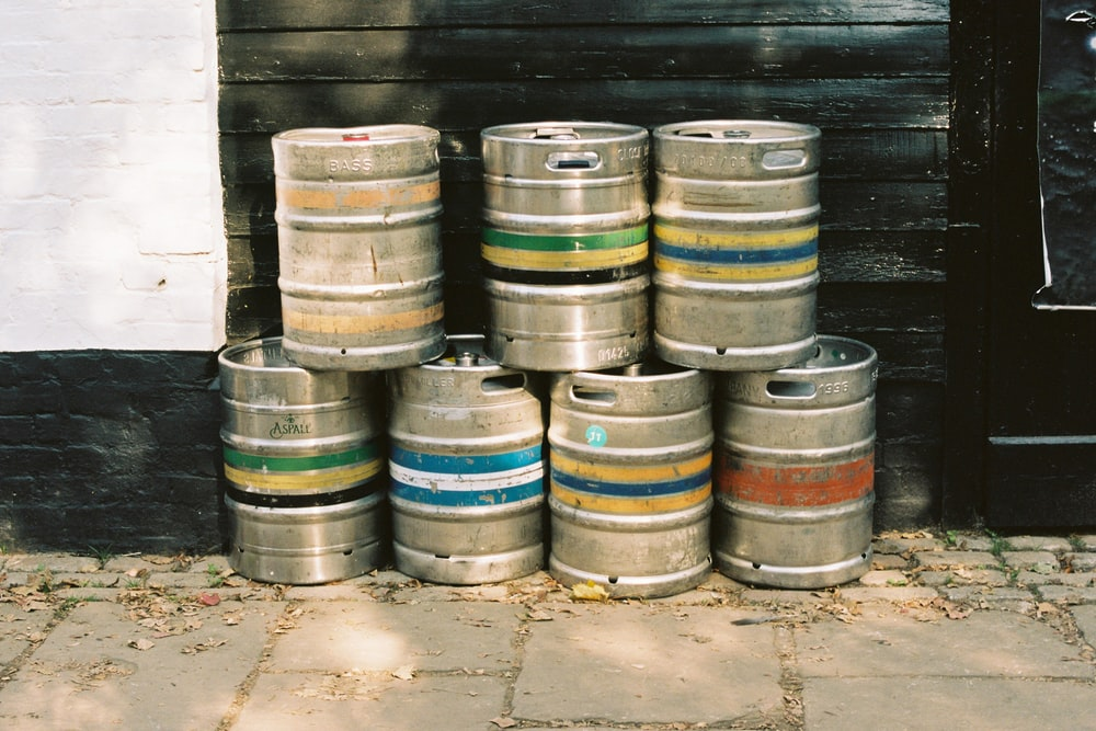 brown wooden barrels on gray concrete floor