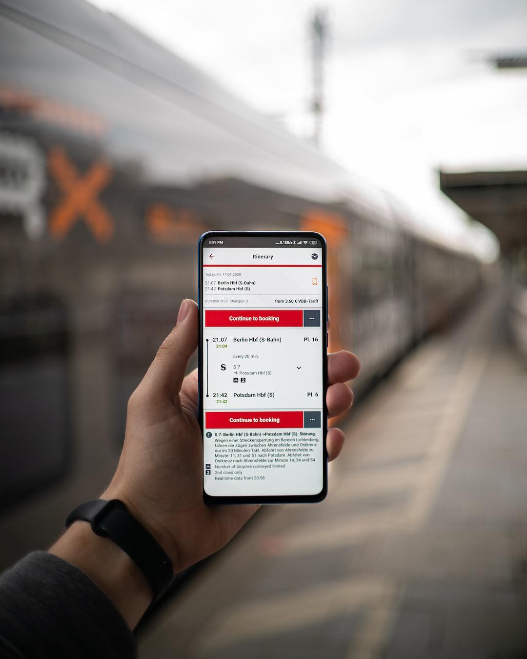 The Deutsche Bahn Streckenplaner app with a train in the background!