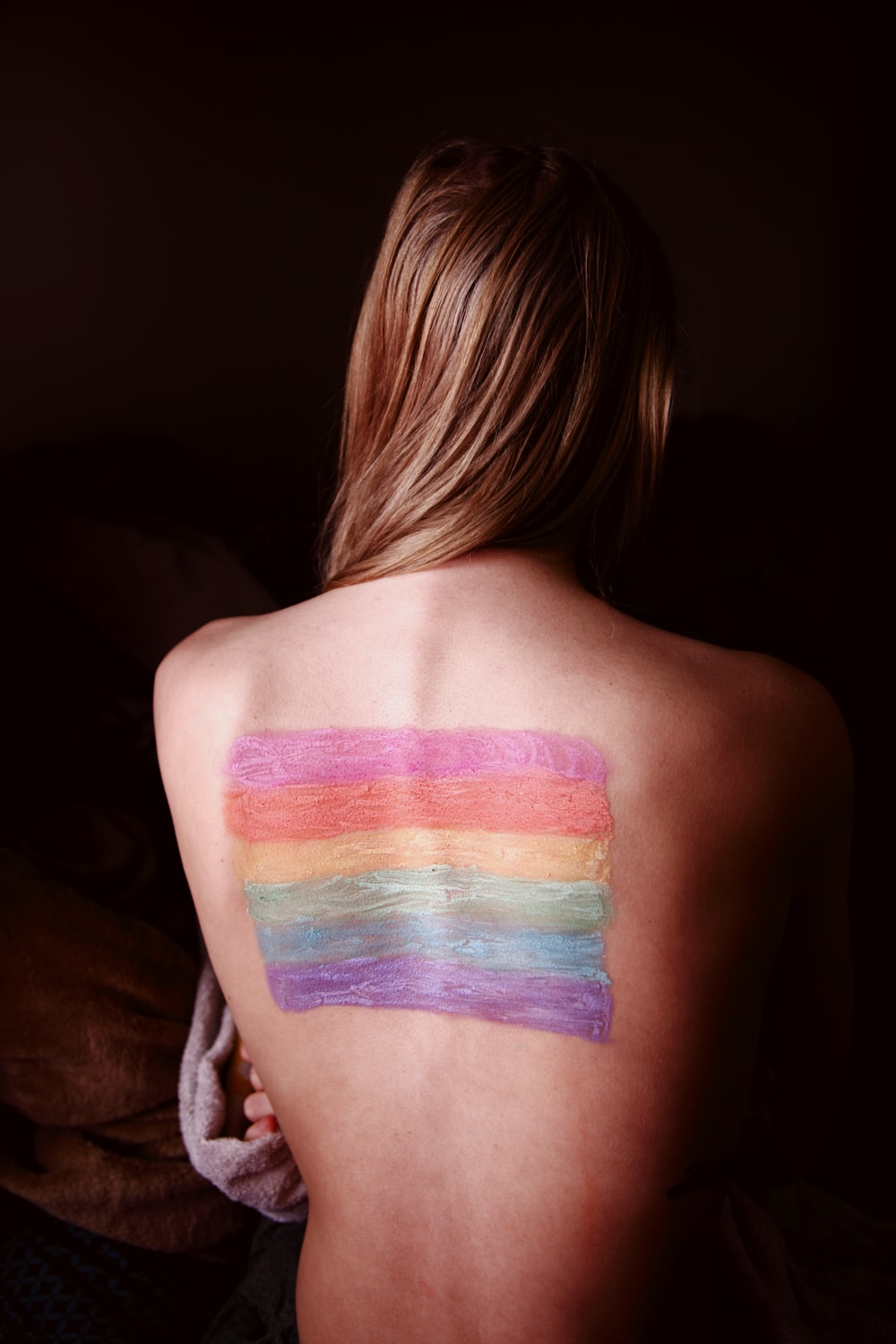 woman with blue and purple paint on her body
