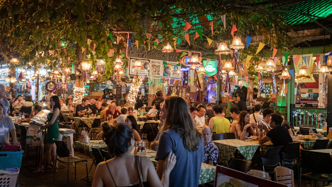People in an open air restaurant at night time